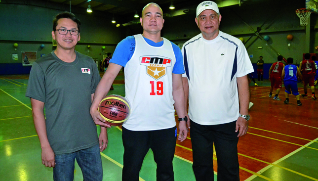 Experienced hands: Officials Paul Esguerra (l), Director Chris Flores and Ric Roces at CMP Sports.