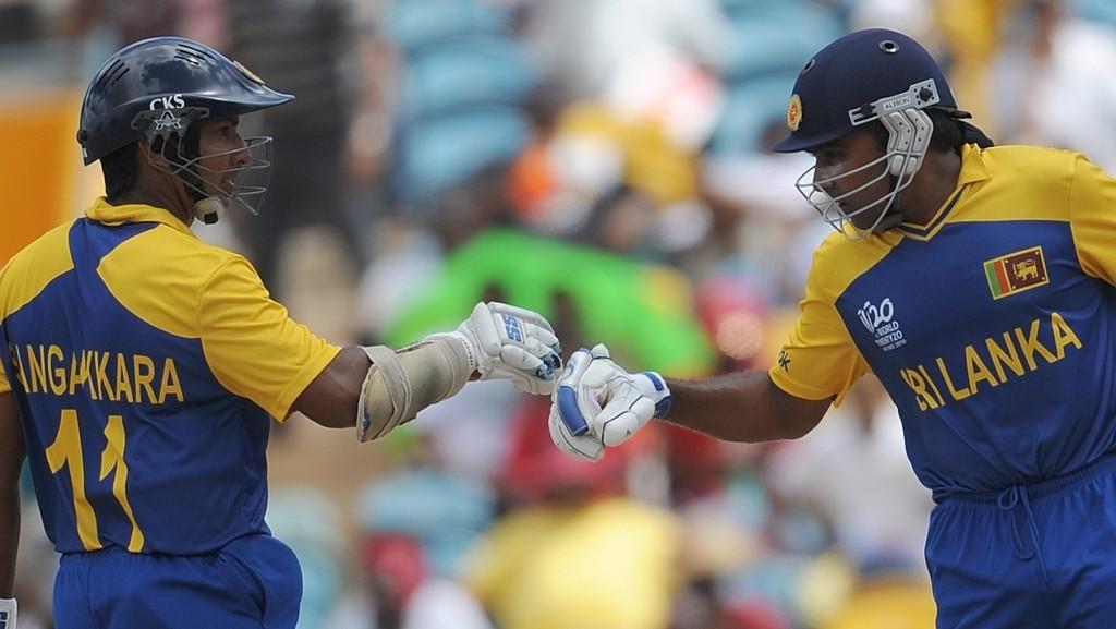 Sri Lanka cricketers Kumar Sangakkara(L) and Mahela Jayawardene punch fists during The ICC World Twenty20 Super 8 match between West Indies and Sri Lanka at the Kensington Oval on May 7, 2010 in Bridgetown, Barbados. AFP PHOTO/Indranil MUKHERJEE (Photo credit should read INDRANIL MUKHERJEE/AFP/Getty Images)