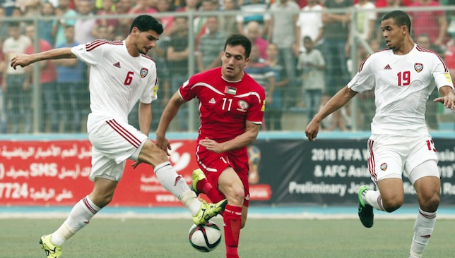 Stalemate: Mohanad Salem (l) vies with Matias Hadwa during the UAE's 0-0 draw in Palestine last September