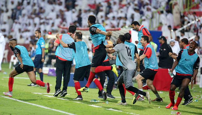 Al Ahli players celebrate their win.