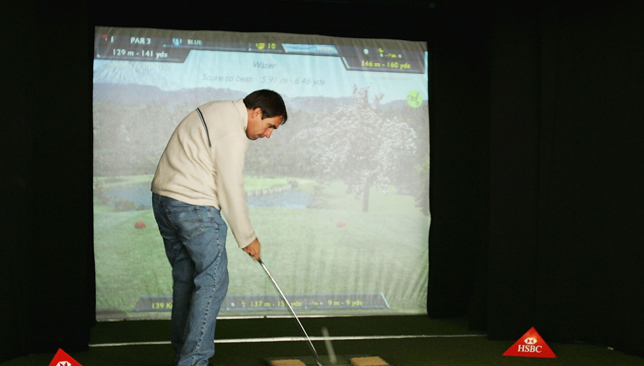 Golf simulators allow participants to play on any course in the world.