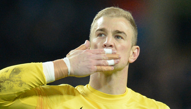 Joe Hart salutes the Manchester City fans after the final whistle.