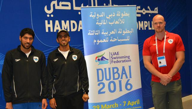 Coach Eetu with UAE swimmers Al Besher and Al Dhaheri