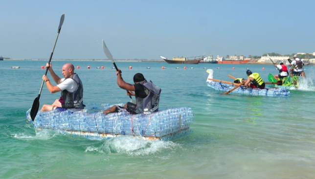 Plastic people: The race is underway as the makeshift rafts hit the water last year.