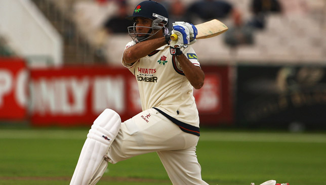 Laxman sweeps while playing for Lancashire.