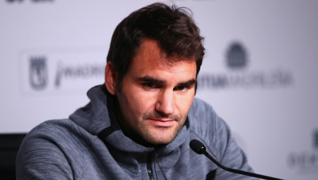 On day 3 of the Madrid Open Federer says that he will play.