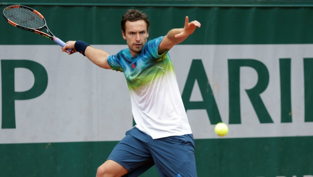 On the fringes: Gulbis on outside court at Roland Garros.