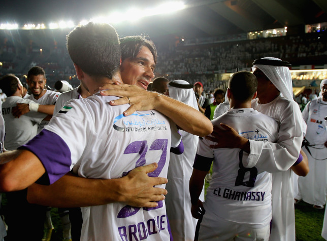 ABU DHABI, UNITED ARAB EMIRATES - MAY 18: Al Ain Manager Zlatko Dalic celebrates with Alex Jason Brosque after winning the Presidents Cup Final match between Al Ain and Al Ahli at Zayed Sports City on May 18, 2014 in Abu Dhabi, United Arab Emirates. (Photo by Francois Nel/Getty Images)