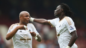 Linked away: Ayew and Gomis.