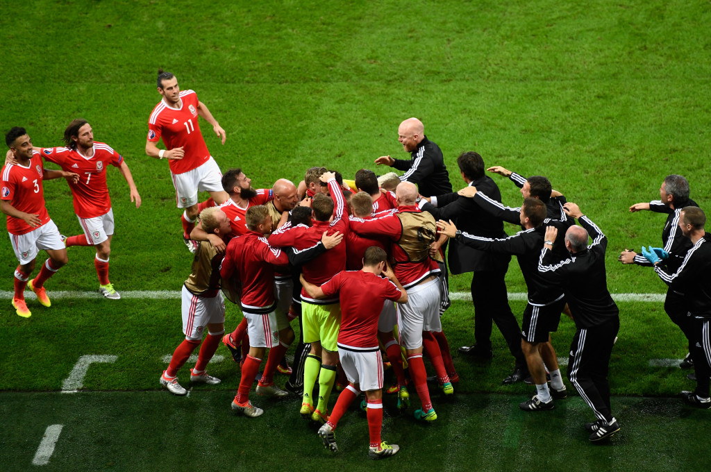Wales players and staff celebrate a truly memorable goal by Hal Robson-Kanu to put them 2-1 up against Belgium.