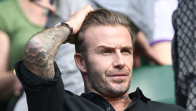 David Beckham watches on.