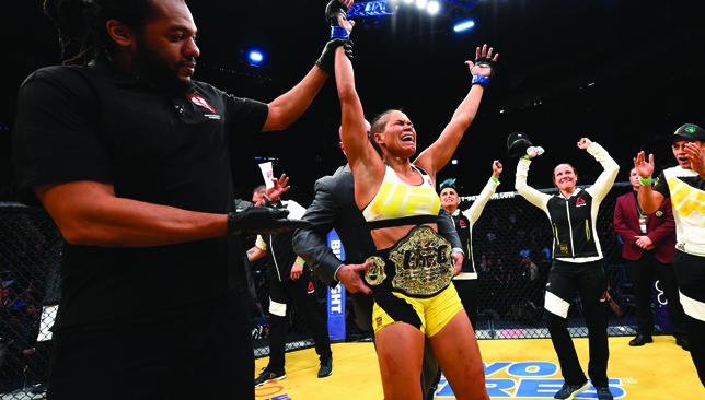Amanda Nunes celebrates after she made quick work of Miesha Tate at UFC 200.