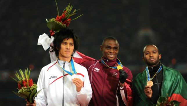 Omar al Salfa on the podium after the men's 200m race in Guangzhou in 2010.