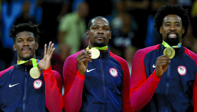 Shining moment: (left to right) Jimmy Butler, Kevin Durant and DeAndre Jordan celebrate with the gold medal.