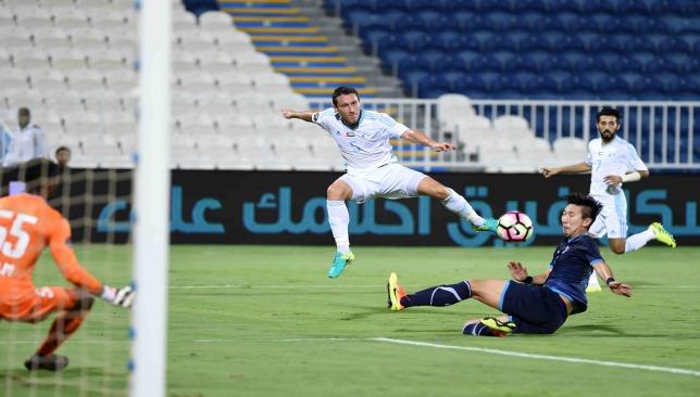 Mark Milligan sees his deflected effort beat goalkeeper Fahad Al Dhanhani.