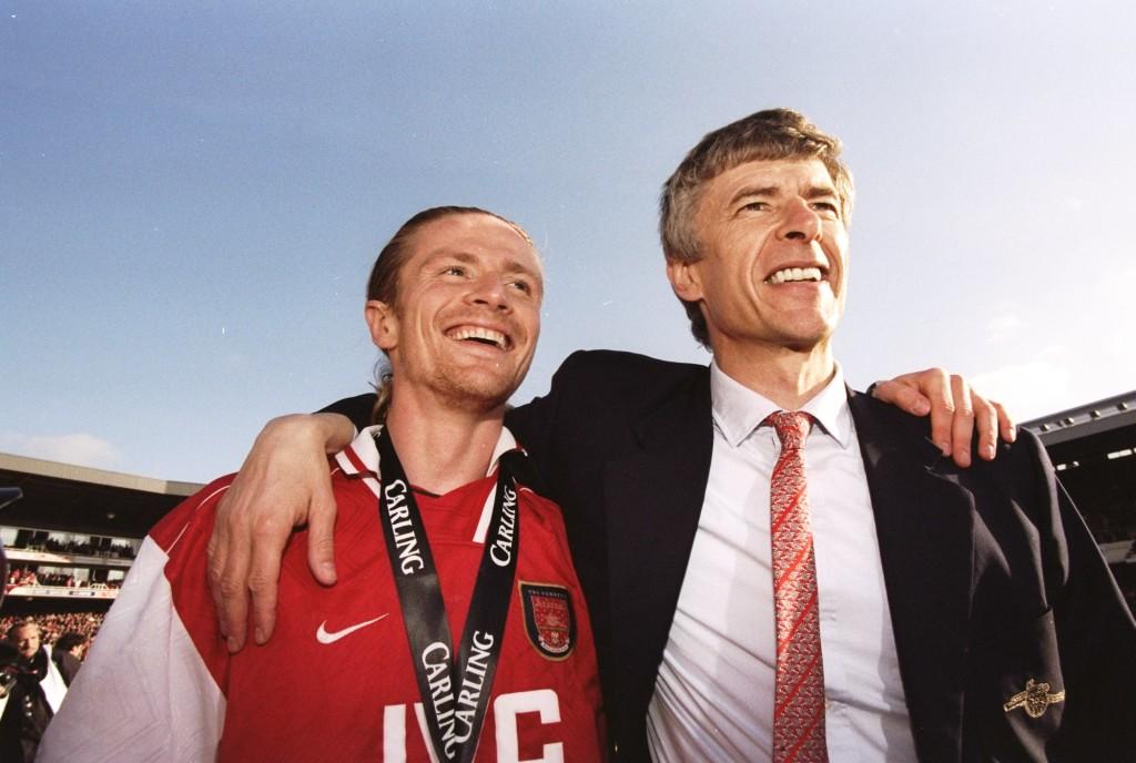 Emmanuel Petit of Arsenal and manager Arsene Wenger
