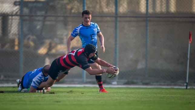 Fabricio D'Amico goes over for the game's opening try
