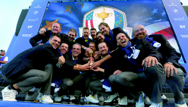 Hands on the trophy: Europe celebrate their triumph in Gleanagles