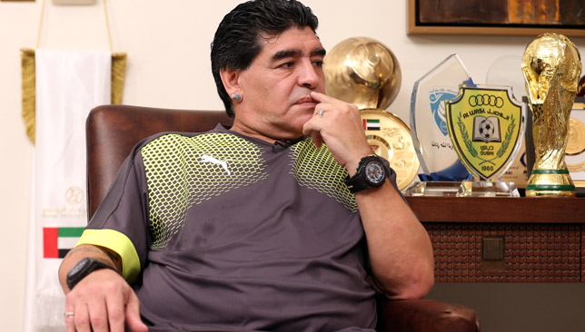 Maradona surrounded by some of his trophies.