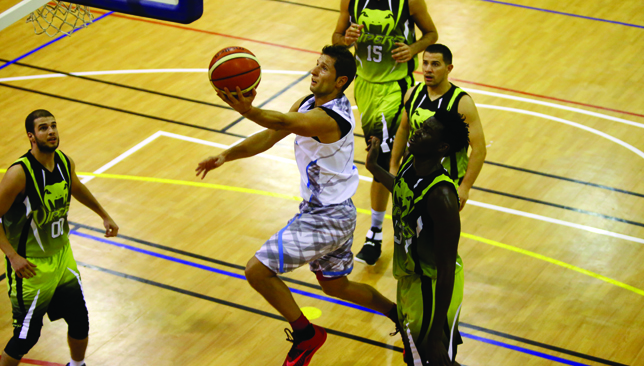 To the hole: Dolphins' Dejan Radulovic scored a game-high 22 points.