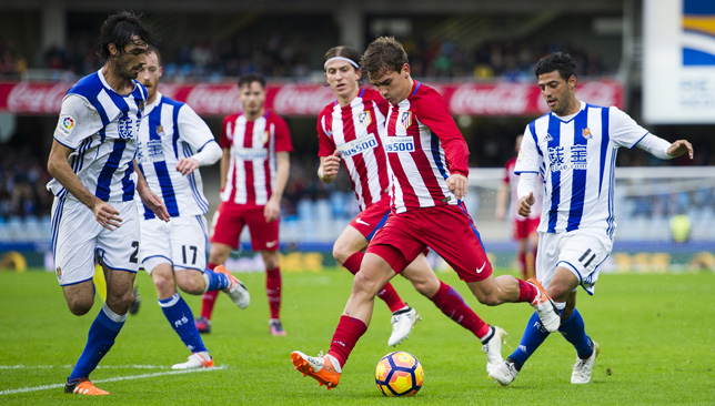 Antoine Griezmann controls the ball against Real Sociedad.
