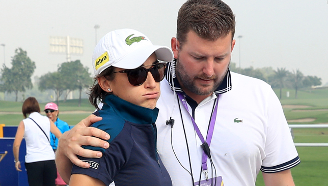 French player Anne-Lise Caudal is consoled in Dubai.
