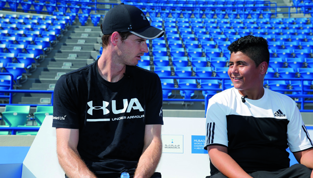 Big fan: Andy with Emirati Hassan.