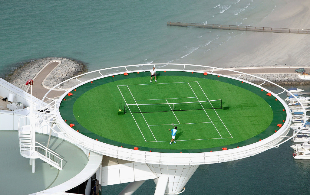 Federer and Agassi on the helipad of Burj Al Arab hotel (Photo by David Cannon for Dubai Duty Free Via Getty)