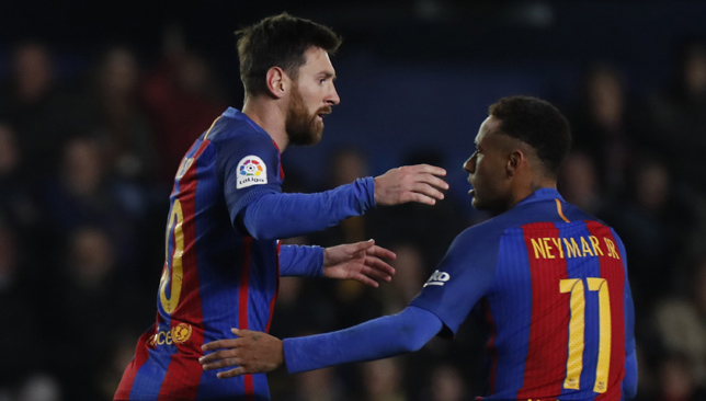 Lionel Messi and Neymar celebrate after Barcelona score an equaliser in stoppage time.