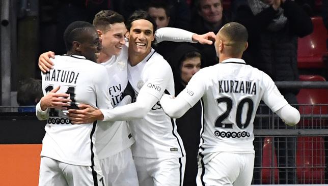 Julian Draxler celebrates with his teammates after scoring.