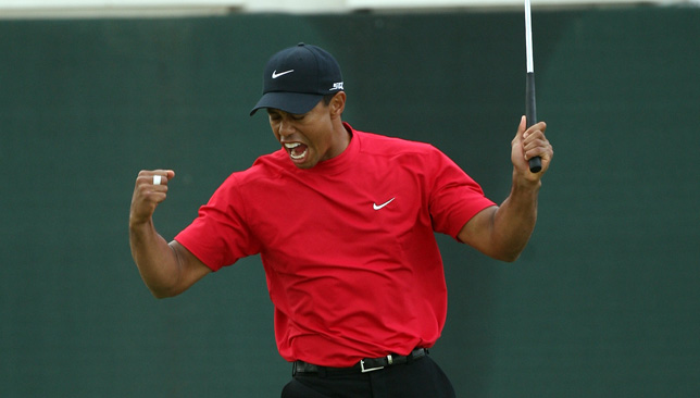 Tiger Woods celebrates after winning the Desert Classic.