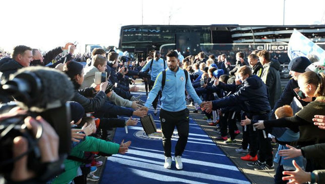 Manchester City players arrive at their stadium.