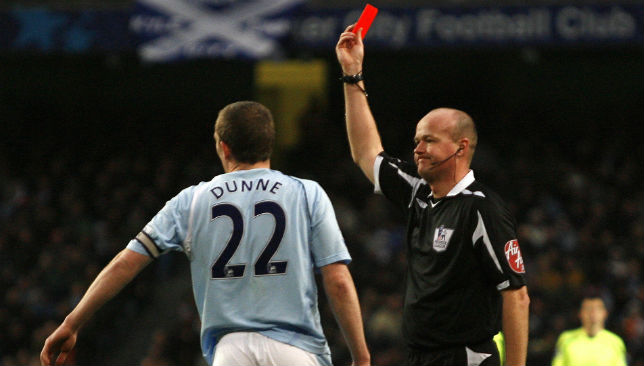 Richard Dunne receiving a red card