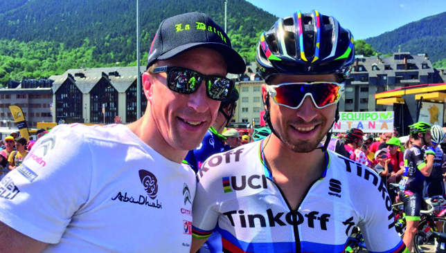 Passion for cycling: Kris Meeke with Peter Sagan (r).