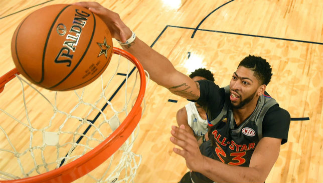 No protection: Anthony Davis gets to the rim during his record haul of 52 points.