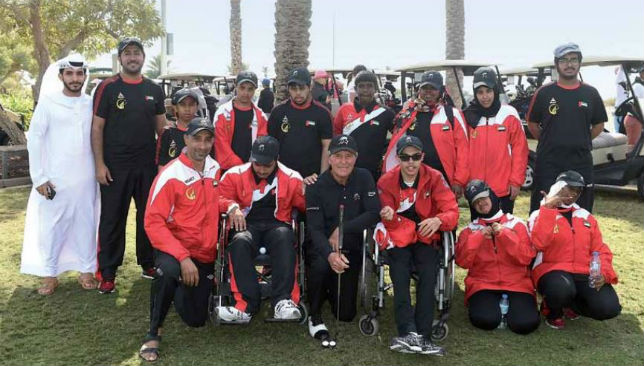 All for the right cause: Gary Player poses with children from the Zayed Higher Organization for Humanitarian Care & Special Needs.