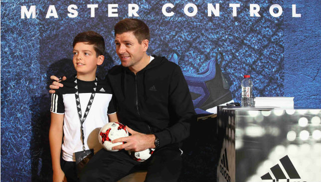 Posing for a picture with a fan: Steven Gerrard