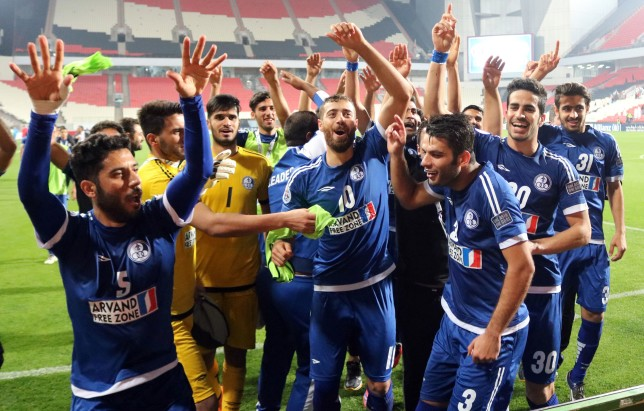 Iran's Esteghlal Khuzestan players celebrate after they won an Asian Champions League Group B football match against UAE's al-Jazira at Mohammed Bin Zayed Stadium on February 27, 2017 in Abu Dhabi.  / AFP / NEZAR BALOUT        (Photo credit should read NEZAR BALOUT/AFP/Getty Images)