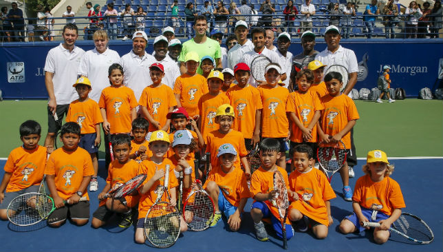 Horia Tecău with kids at the ATP Tennis Emirates Coaching Clinic