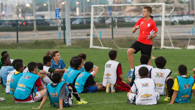 Scout Enrique runs the scouted players through the drills to come