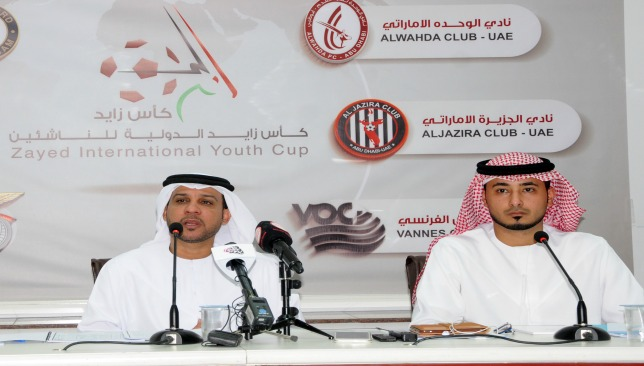 Former Al Wahda player and current academy director, Adel Khamis (l)