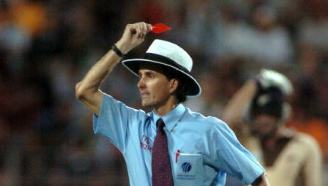 Billy Bowden jokingly showing a red card during a T20I.