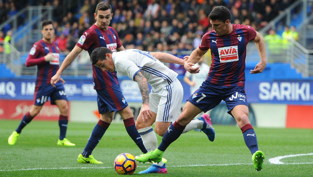 Eibar players try to win the ball from James Rodriguez.