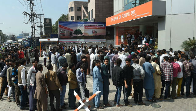 Fans queue to buy tickets for the PSL final in Lahore.