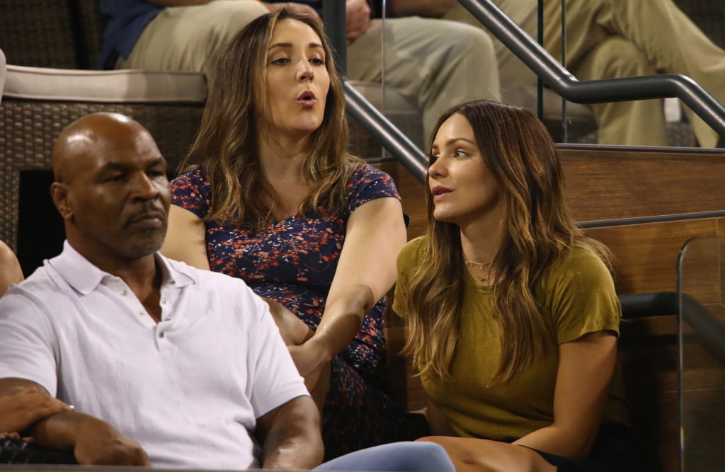 Retired boxer Mike Tyson and actress/singer Katharine McPhee watch Pospisil defeat Murray.