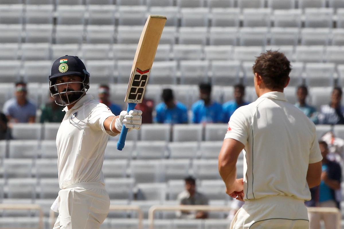 Pujara, Saha frustrate Australia as India close on lead