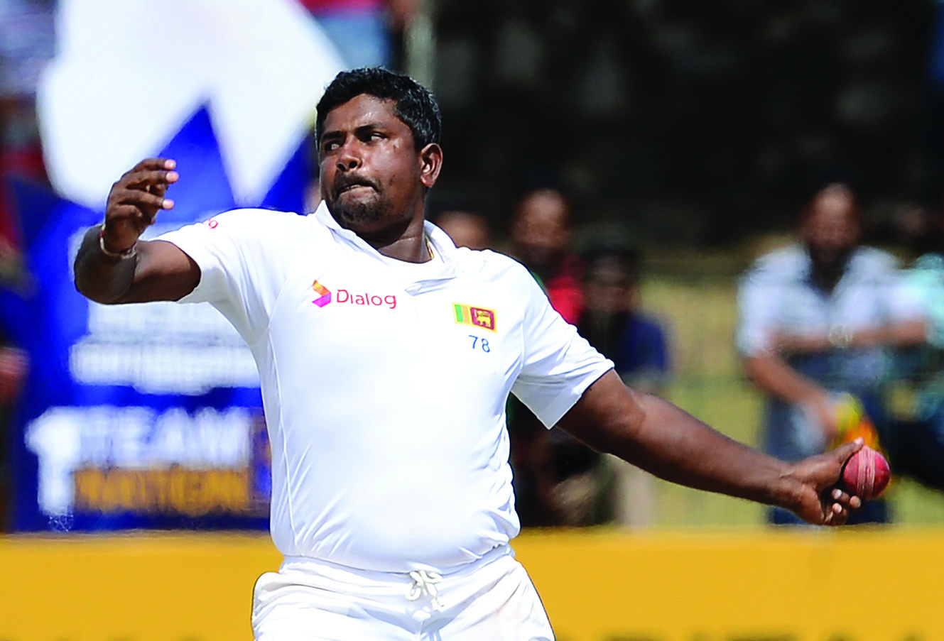 Sri Lanka's Rangana Herath delivers a ball during the final day of the third and final Test match between Sri Lanka and Australia at The Sinhalese Sports Club (SSC) Ground in Colombo on August 17, 2016.  / AFP / LAKRUWAN WANNIARACHCHI        (Photo credit should read LAKRUWAN WANNIARACHCHI/AFP/Getty Images)