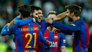Barcelona players celebrate after Leo Messi's extra-time winner in El Clasico.