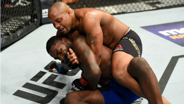 No way out: Daniel Cormier forces the tap from Anthony Johnson to retain his title.