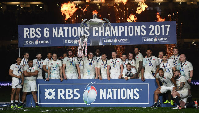 England Rugby Team players celebrate with the Six Nations trophy.
